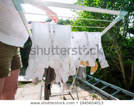 baby clothes on line outside in rural garden Stock photo © travelphotography