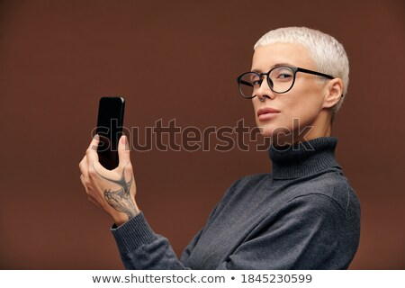Male hand holding a mobile phone with space for you text stock photo © Len44ik