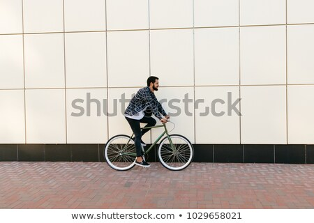 Side view of man riding bicycle Stock photo © zzve
