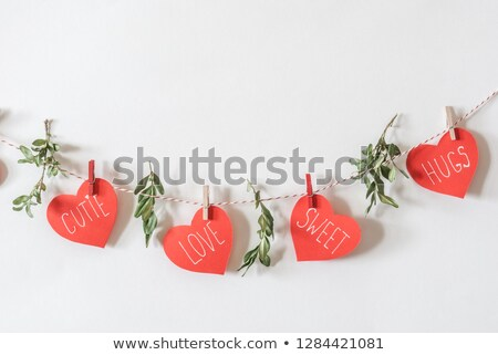 postcard on valentines day with the heart of a suspended stock photo © yurkina