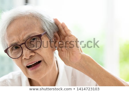 man having difficulty in hearing Stock photo © ichiosea