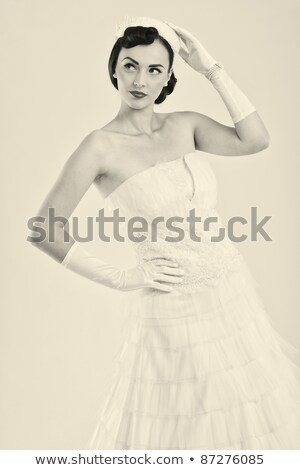 Beautiful brunette girl wearing in wedding dress isolated on pin Stock photo © Victoria_Andreas