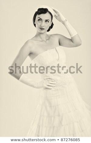 Stock photo: Beautiful brunette girl wearing in wedding dress isolated on pin