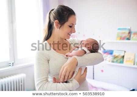 Közelkép nő hordoz baba fiú család Stock fotó © bmonteny