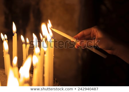 Many lighted candles Stock photo © smuki