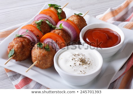 asian meatballs with sauce stock photo © klinker