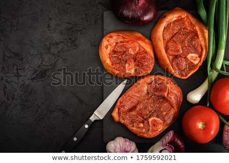raw pork shank on a plate with spices and vegetables Stock photo © OleksandrO