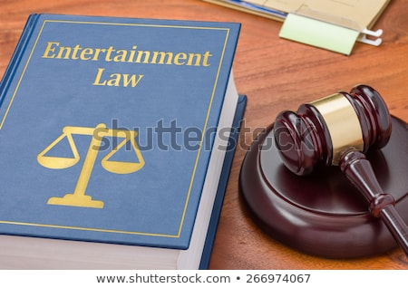 A law book with a gavel - Entertainment law Stock photo © Zerbor