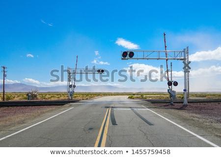 Train Passing Railroad Crossing Warning Lights Flashing Stock photo © cboswell