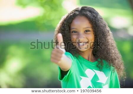 Young environmental activist smiling at the camera showing thumb Stock photo © wavebreak_media