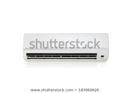 Witte kleur airconditioner machine geïsoleerd licht Stockfoto © ozaiachin