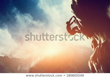 Adam gün batımı örnek duvar kaya özgürlük Stok fotoğraf © adrenalina