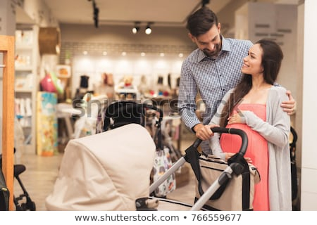 Pregnant woman buying baby bed in store Stock photo © Kzenon