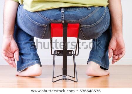 Nadwaga boso człowiek malutki krzesło widok z tyłu Zdjęcia stock © ozgur