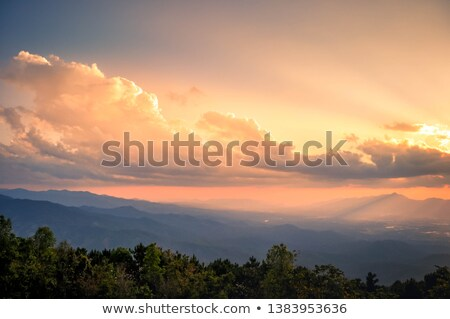 Sun Rays Over Mountains Stock photo © pancaketom