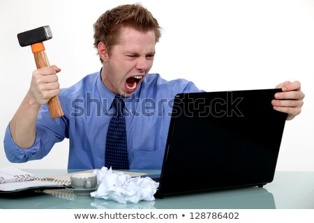 angry man about to destroy his laptop Stock photo © Giulio_Fornasar