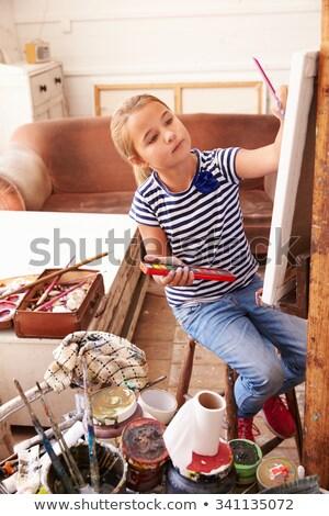Fiatal lány festmény festőállvány lány festék oktatás Stock fotó © IS2