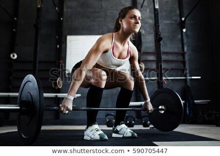 Alulról fotózva kilátás nő emel súlyok fitnessz Stock fotó © IS2