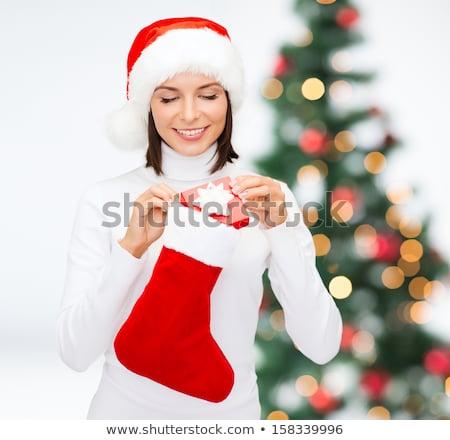 Dziewczyna patrząc christmas pończocha Zdjęcia stock © IS2