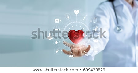 Doctor holding a red heart shape Stock photo © CsDeli