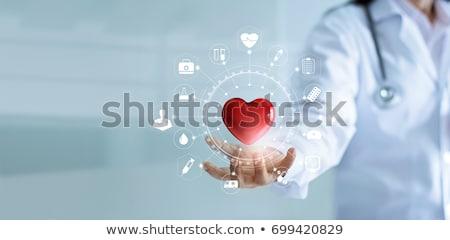 Orvos tart piros szív alak női nő Stock fotó © CsDeli