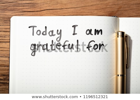 Stock photo: Gratitude Word With Pen On Notebook