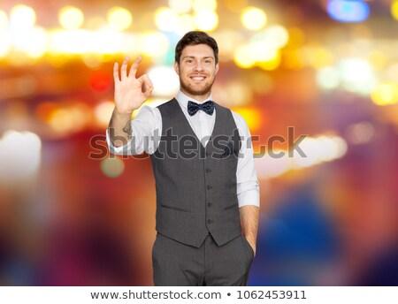 Homem terno assinar noite Foto stock © dolgachov