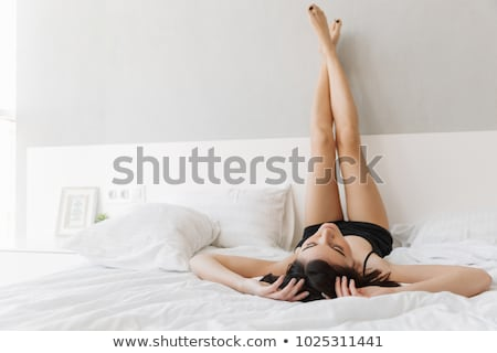beautiful woman in underwear lies on the bed in the bedroom tonight Stock photo © dmitriisimakov