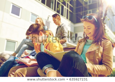 group of students with notebooks at school yard stock photo © dolgachov