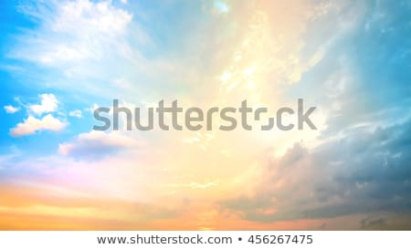 Sunset with sun on blue dramatic sky Stock photo © vapi