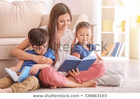 madre · lettura · figlio · divano · famiglia · sorriso - foto d'archivio © Lopolo