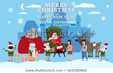 santa claus and helper children on winter holidays stock photo © robuart