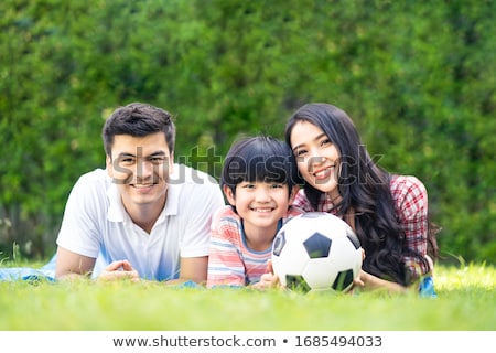 Nice Happy family lifestyle play soccer outside Stock photo © Lopolo