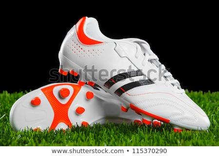 Legs of boy footballer in boots football cleats Stock photo © matimix
