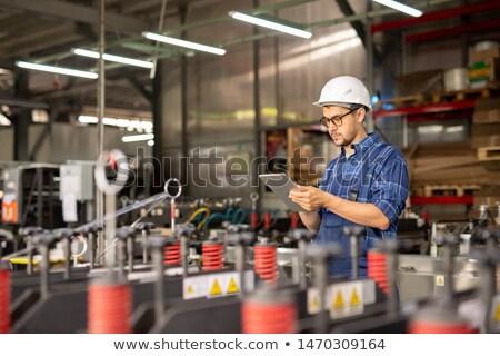Mechanic browsing in the net Stock photo © pressmaster