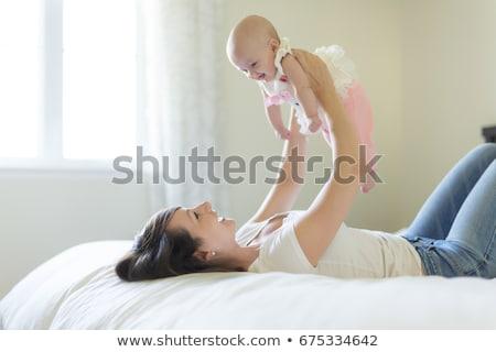 młodych · ojciec · dziewięć · miesiąc · starych · bed - zdjęcia stock © lopolo