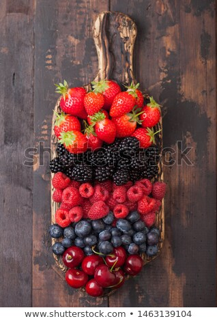Photo stock: Fresh Organic Summer Berries Mix On Vintage Wooden Chopping Board On Dark Wooden Table Background R