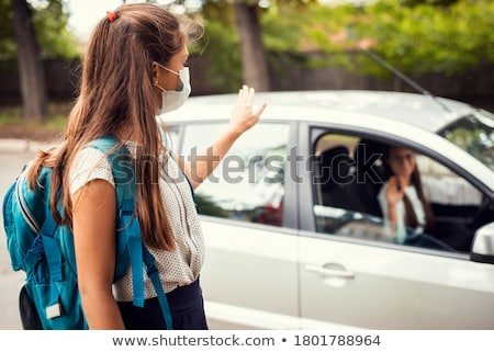 Mother wishing her daughter a happy day at school Stock photo © Kzenon