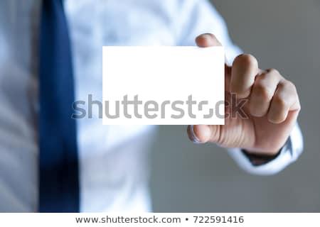business man holding blank card in office stock photo © wavebreak_media