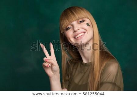 teenage girl in green clothes at patricks day Stock photo © dolgachov