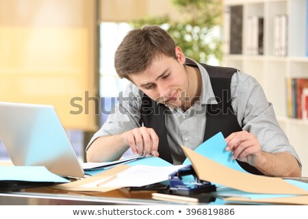 Desultory businessman at desk. Stock photo © lichtmeister