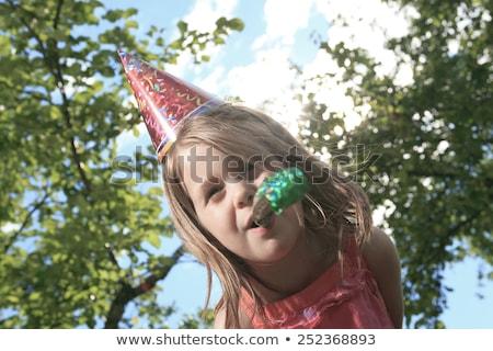 Meisje buiten verjaardag hoed trompet partij Stockfoto © Lopolo