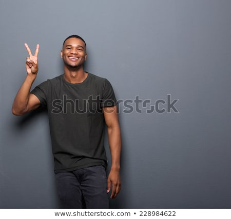 happy man showing two fingers or peace hand sign Stock photo © dolgachov