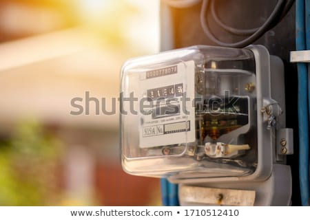 An electrician checking the energy meter. Stock photo © photography33