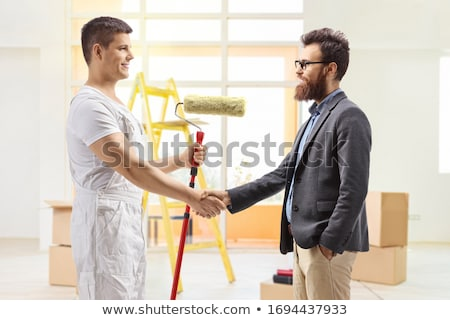 Stock photo: Painter restoring apartment