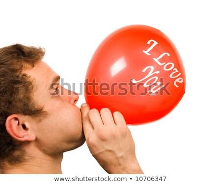 Man blowing red balloon Stock photo © Hofmeester