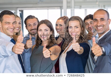 Smiling matured businessman showing thumbs-up Stock photo © stockyimages