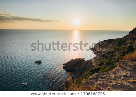 Stock photo: cliff and the boats