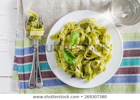 Tagliatelle pasta with pesto on white plate Stock photo © ozaiachin