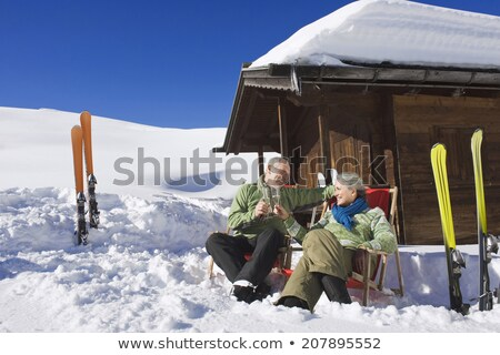 couple in front of a ski cabin stock photo © photography33